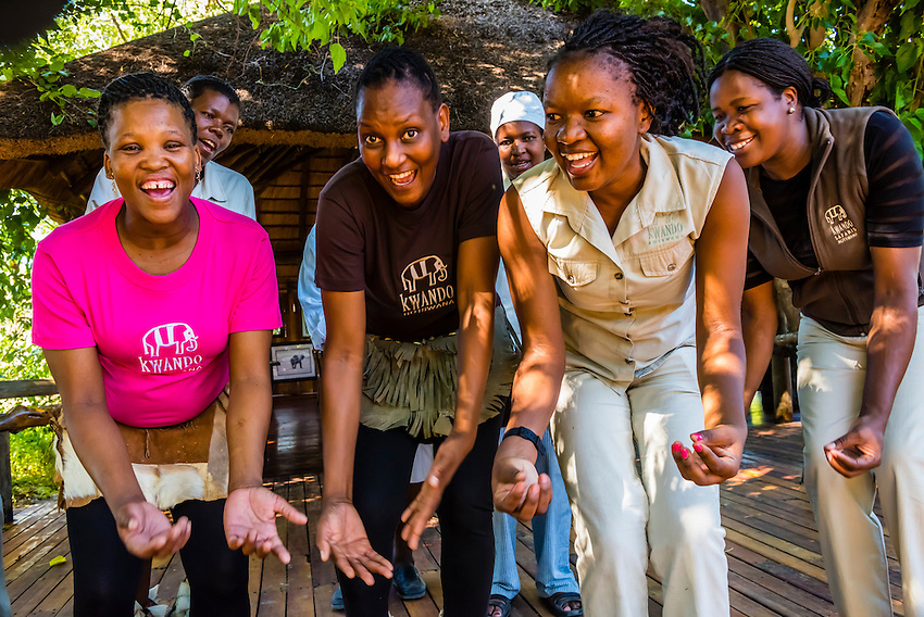 Staff members of the Lebala Safari Camp at the Kwando Concession do a traditional singing and dancing performance, Botswana.