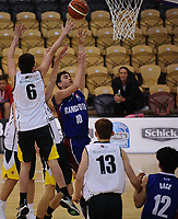 Ethan Mandeno lays a shot up during the 2017 AA Boys' Secondary Schools Basketball Premiership National Championship match between Waimea College (white) and Rangitoto College (blue and burgundy) at the B&M Centre in Palmerston North, New Zealand on Tuesday, 3 October 2017. Photo: Dave Lintott / lintottphoto.co.nz