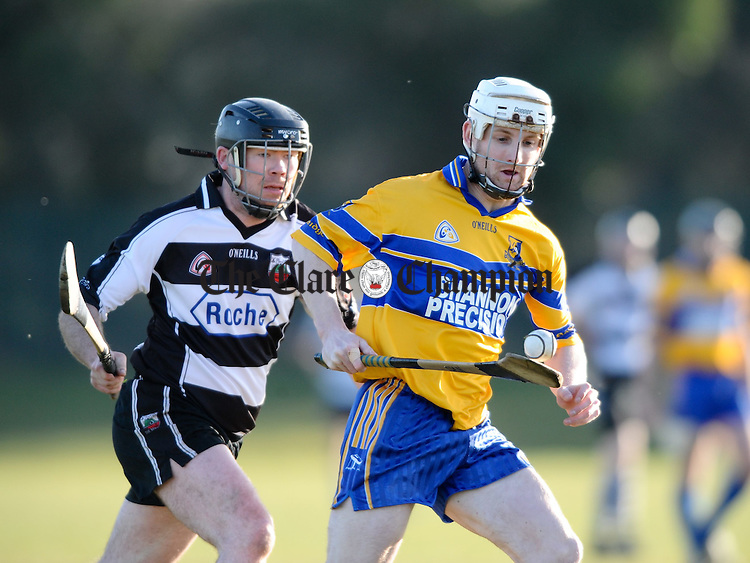 Clarecastle's Ollie Plunkett in action against Sixmilebridge's Danny Morey during their Clare Champion Cup game at Clarecastle. Photograph by John Kelly.