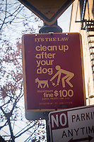 "A sign admonishing pet owners to pick up after their dogs do their business is seen in the Greenwich Village neighborhood of New York on Thursday, November 28, 2013. The NYC Dept. of Transportation  is removing the signs in an effort to reduce visual clutter on the street. The signs are consider redundant as pet owners already know about the ""pooper scooper"" law, enacted in 1978. The signs have not been maintained in ten years and the fine is now $250.(© Richard B. Levine)"