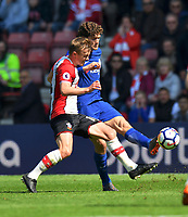 Southampton's James Ward-Prowse (left) battles with Chelsea's Marcos Alonso (right) <br /> <br /> Photographer David Horton/CameraSport<br /> <br /> The Premier League - Southampton v Chelsea - Saturday 14th April2018 - St Mary's Stadium - Southampton<br /> <br /> World Copyright &copy; 2018 CameraSport. All rights reserved. 43 Linden Ave. Countesthorpe. Leicester. England. LE8 5PG - Tel: +44 (0) 116 277 4147 - admin@camerasport.com - www.camerasport.com