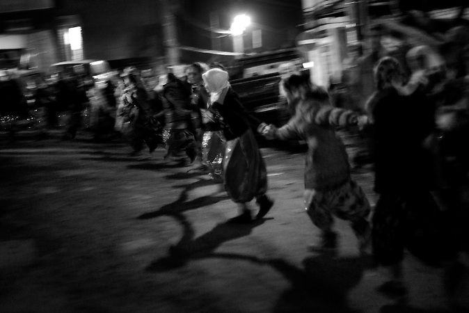 Djamal and Fatme's friends and relatives are dancing during the celebration of the wedding ceremony in the village of Ribnovo, some 200 km from Sofia, Bulgaria.