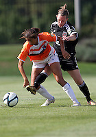 BOYDS, MARYLAND - July 22, 2012:  Mikaela Howell (8) of DC United Women kicks the ball away from Kaley Blanton (5) of the Charlotte Lady Eagles during the W League Eastern Conference Championship match at Maryland Soccerplex, in Boyds, Maryland on July 22. DC United Women won 3-0.