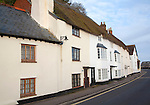 Row of old traditional cottages on the quayside in Minehead, Somerset, England