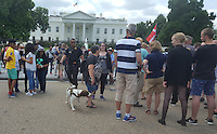 Washington DC, July 9, 2016, USA--A member of the Secret Service K-9 corp walks through a crowd of tourists gathered in front of the White House. Security in the Washington DC area has been increased due to the spike of violence occuring around the United States.  Patsy Lynch/MediaPunch