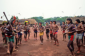 A - Ukre village, Xingu Indigenous Area, Para State, Brazil.  Kayapo Indians doing a hunting ceremony.