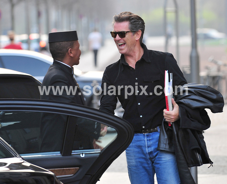 **ALL ROUND EXCLUSIVE PICTURES FROM SOLARPIX.COM**.**SYNDICATION RIGHTS FOR UK AND SPAIN ONLY**.Actor Pierce Brosnan arrives the Hotel Ritz Carlton in Berlin Germany...This pic:Pierce Brosnan..JOB REF:8770          CPR/GRIMM        DATE:04.04.09.**MUST CREDIT SOLARPIX.COM OR DOUBLE FEE WILL BE CHARGED**.**ONLINE USAGE FEE GBP 50.00 PER PICTURE - NOTIFICATION OF USAGE TO PHOTO @ SOLARPIX.COM**.**CALL SOLARPIX : +34 952 811 768 or LOW RATE FROM UK 0844 617 7637**