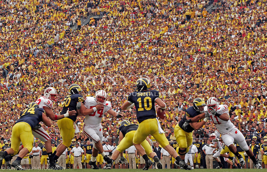 Michigan quarterback Steven Threet (10) scrambles in the pocket in the first half of an NCAA college football game with Wisconsin, Saturday, Sept. 27, 2008, in Ann Arbor, Mich. Michigan upset ninth ranked Wisconsin 27-25. (AP Photo/Tony Ding)