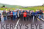 Mr. Brendan Griffin, T.D., Minister of State for Tourism & Sport cuts the ribbon at the  official opening of the N86 Lispole to Ballynasare Lower and Ballygarret to Camp Road Improvement Scheme on Tuesday.