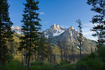 McGowan peak in the Sawtooth Range, rises to 9860 Ft. Seen here in the last light of a summer day. Stanley, Idaho