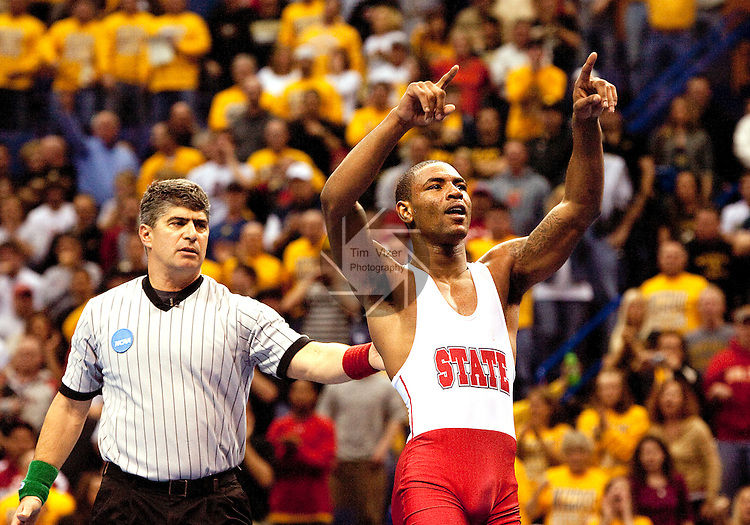 March 21 2009      Darrion Caldwell from North Carolina State (white and red uniform) defeated Brent Metcalf from Iowa (not shown) in the 149 pound weight class in the championship round of the NCAA Division I  Wrestling Championships which were held March 19 through March 21, 2009 at the Scottrade Center in downtown St. Louis, Missouri.  Caldwell reacts here...         *******EDITORIAL USE ONLY*******
