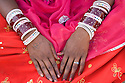 Rajasthani dancer/girl wearing bracelets, Thar Desert, Rajasthan, India --- Model Released