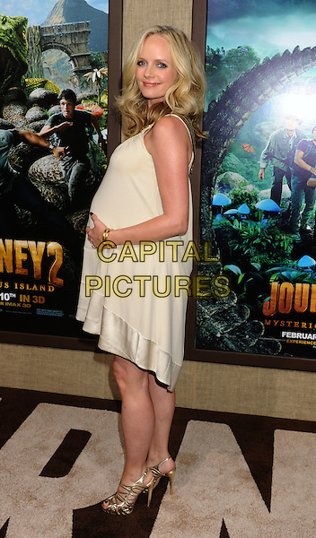 """Marley Shelton.arriving at the Los Angeles premiere of """"Journey 2: The Mysterious Island"""" at Grauman's Chinese Theatre in Hollywood, California, USA, .February 2nd 2012. .full length side dress  cream gold strappy sandals shoes pregnant .CAP/ROT/TM.©TM/Roth Stock/Capital Pictures"""