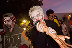 "Oct. 30, 2009 -- PHOENIX, AZ: Zombie SARAH LADAS ""dines on human flesh"" (actually a theatre prop) during the Zombie Walk in Phoenix Friday. About 200 people participated in the first ""Zombie Walk"" in Phoenix, AZ, Friday night. The Zombies walked through downtown Phoenix ""attacking"" willing victims and mixing with folks going to the theatre and downtown sports venues.  Photo by Jack Kurtz"