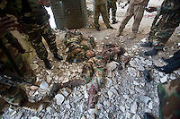 Bodies of al-Shabaab militants, dressed in Somali National Army fatigues, lay dead on the floor after the siege.