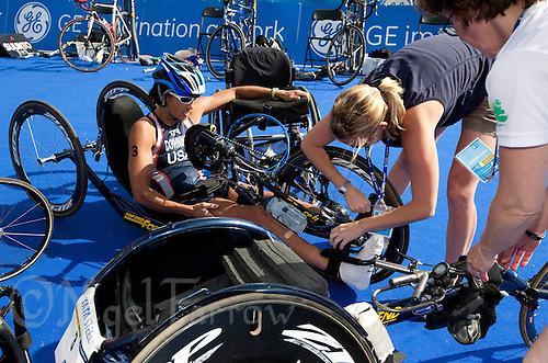 24 JUL 2010 - LONDON, GBR - Supporters help Tricia Downing from her hand bike during the London round of the ITU World Championship Series Paratriathlon (PHOTO (C) NIGEL FARROW)