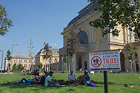 Illegal migrants sit in a public park close to a transit zone at the main railway station Keleti in Budapest, Hungary on August 30, 2015. ATTILA VOLGYI