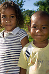 Vuna Village, Taveuni, Fiji; two grandchildren of the sitting chief of Vuna Village pose for photos after the chief granted permission to tour the village