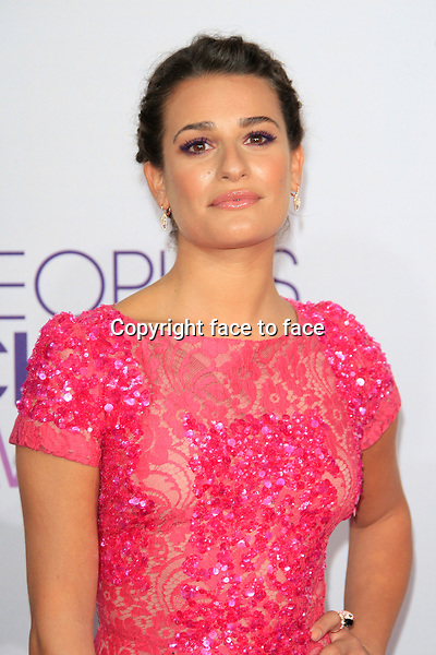 Lea Michele (in an Elie Saab pink short sleeve cocktail dress with embellished lace detailing and pink strappy heels, Anita Ko jewels, and a Jimmy Choo bag) attending the 34th Annual People's Choice Awards at the Nokia Theatre in Los Angeles, California, January 9, 2013...Credit: Martin Smith/face to face