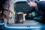 Susan Smith and another volunteer for H.A.R.P. (Homeless Animal Response Program), of Antioch, discuss a recently trapped cat in Antioch, California, on Friday, March 21, 2014.  Photo/Victoria Sheridan