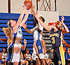 Anna Zaborowska #5, left, and Emilyae Ward #2 of Copiague, center, go up for a rebound alongside Heather Jerome #3 of Northport during a Suffolk County League II varsity girls' basketball game at Copiague High School on Thursday, Jan. 28, 2016. Copiague won by a score of 59-52.
