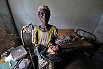 A woman holds a newborn baby in a hospital in the remote village of Minga that was started by Methodist missionaries and is today operated jointly by the United Methodist Church and the Congolese government.