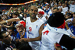 French national basketball team player Tony Parker celebrate victory with fans and supporters after semifinal basketball game between France and Russia in Kaunas, Lithuania, Eurobasket 2011, Friday, September 16, 2011. (photo: Pedja Milosavljevic)