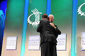 Former United States President Bill Clinton hugs United States President Barack Obama after giving his introduction at the Clinton Global Initiative gathering Wednesday, September 21, 2011 at the Sheraton New York Hotel and Towers in New York, New York..Credit: Aaron Showalter / Pool via CNP