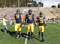California captains Freddie Tagaloa, Deandre Coleman and Jackson Bouza walk on the field for coin toss before NCAA football game against USC at Memorial Stadium in Berkeley, California on November 9th, 2013.   USC defeated California, 62-28.