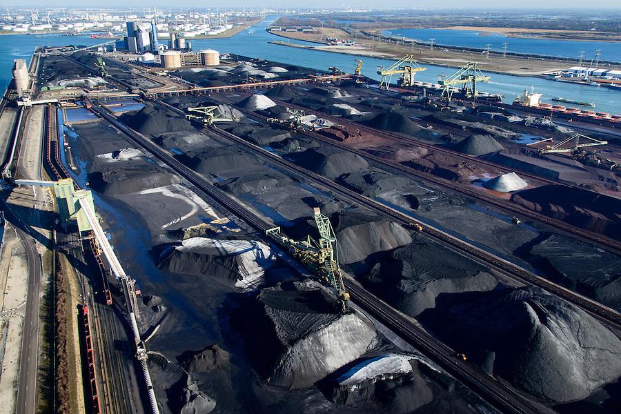 Nederland, Zuid-Holland, Rotterdam, 18-02-2015; Eerste Maasvlakte met Europees Massagoed Overslagbedrijf (EMO). Gespecialiseerd in de overslag van kolen en ijzererts.<br /> In de achtergrond BP raffinaderij.<br /> EMO transhipment terminal for coal and iron ore and other dry bulk.<br /> luchtfoto (toeslag op standard tarieven);<br /> aerial photo (additional fee required);<br /> copyright foto/photo Siebe Swart