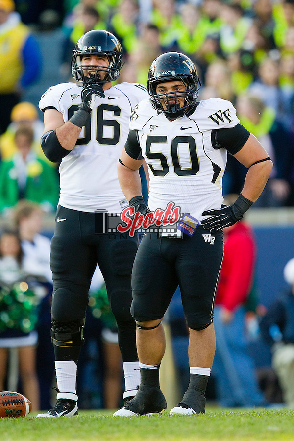Nikita Whitlock (50) and Hasan Hazime (96) of the Wake Forest Demon Deacons during first half action against the Notre Dame Fighting Irish at Notre Dame Stadium on November 17, 2012 in South Bend, Indiana.  The Fighting Irish defeated the Demon Deacons 38-0.  (Brian Westerholt/Sports On Film)