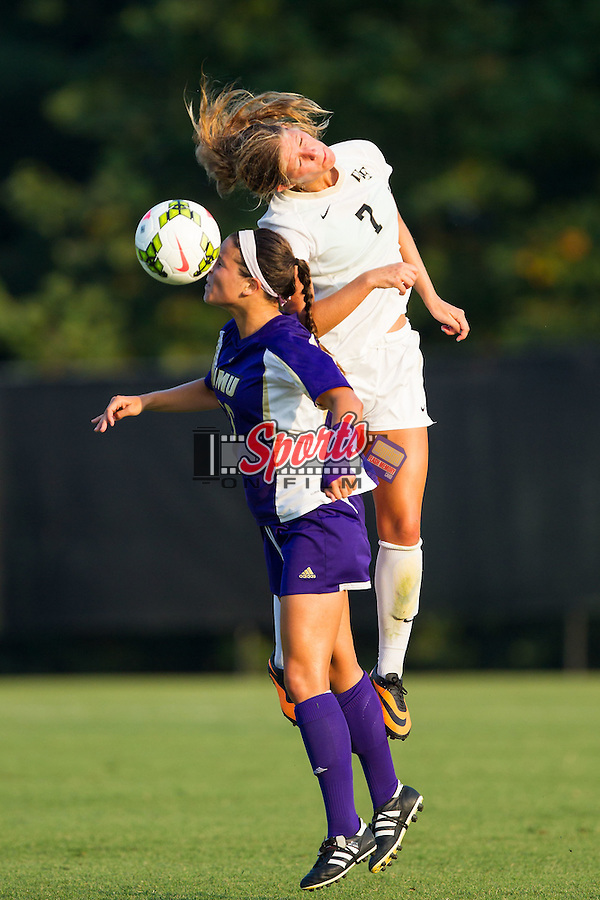 Sarah Teegarden (7) of the Wake Forest Demon Deacons heads the ball away from Kelly Kerrigan (10) of the James Madison Dukes during second half action at Spry Soccer Stadium on August 29, 2014 in Winston-Salem, North Carolina.  The Dukes defeated the Demon Deacons 2-1.   (Brian Westerholt/Sports On Film)