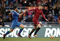 Calcio, Serie A: AS Roma - Sassuolo, Roma, stadio Olimpico, 30 dicembre 2017.<br /> Roma's Edin Dzeko (r) is going to score contrasted by Sassuolo's captain Francesco Magnanelli (l) during the Italian Serie A football match between AS Roma and Sassuolo. Rome's Olympic stadium, 30 December 2017.<br /> UPDATE IMAGES PRESS/Isabella Bonotto