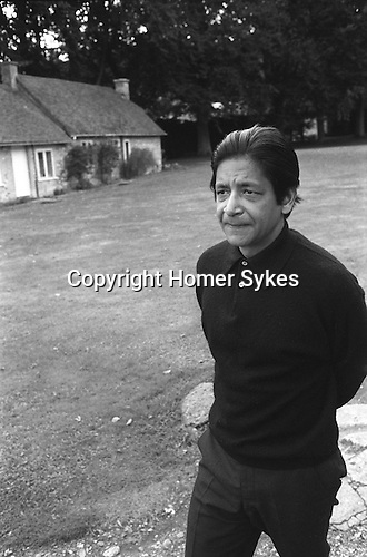 VS Naipaul outside his Oxfordshire cottage home in 1971. England. ..My ref 20/290/, 1971,