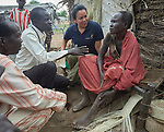 Heydi Foster (center), the CEO of Misean Cara, talks with a woman in the Doro Refugee Camp in Maban, South Sudan. The camp is one of four in Maban that together shelter more than 130,000 refugees from the Blue Nile region of Sudan. Misean Cara supports the work of Jesuit Refugee Service in the Maban camps.