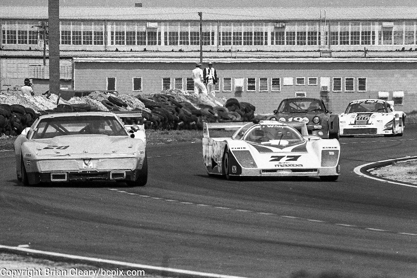 #77 Mazda GTP of Pierre Honegger and Walt Bohren (66th place) and # 20 Pontiac Firebird of  Paul Canary and Jim Sanborn (64th place) 12 Hours or Sebring, Sebring International Raceway, Sebring, FL, March 19, 1983.  (Photo by Brian Cleary/bcpix.com)