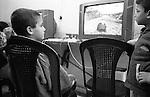 Shatila, UNRWA camp. The boys gather in one of the many game halls inside the camp before or after school. Due to limited space, schools shift classes: The &quot;Ramallah&quot; school for boys becomes the &quot;Hama&quot; school for girls in the afternoon. The sequence is changed every month.<br />  <br /> Chatila, camp de l'UNRWA. Apr&egrave;s ou avant l'&eacute;cole, les gar&ccedil;ons se retrouvent dans les multiples salles de jeux &agrave; l'int&eacute;rieur du camp. A cause de l'espace limit&eacute;, l'&eacute;cole &laquo;Ramallah&raquo; pour gar&ccedil;ons devient l'&eacute;cole &laquo;Hama&raquo; pour filles l'apr&egrave;s-midi. Chaque mois l'ordre est chang&eacute;...