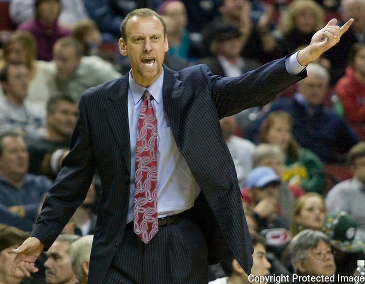 Milwaukee Bucks'  head coach Larry Krystkowiak  sends in a defensive play against the Seattle SuperSonics' in a NBA basketball game during the second half Friday, Dec. 7, 2007 in Seattle. Jim Bryant Photo. ©2010. All Rights Reserved...