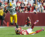 Green Bay Packers receiver Donald Driver, left, makes a catch beside Washington Redskins cornerback DeAngelo Hall during the fourth quarter of the game at FedEx Field in Landover, Md., on Oct. 10, 2010.
