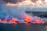 Aerial view of ocean entry zone at Ahalanui where lava from Kilauea Volcano east rift zone erupting from Fissure 8 near the town of Pahoa drains downhill through Kapoho to meet the sea, boiling the sea water and releasing clouds of acidic steam known as laze, Big Island, Hawaii, USA
