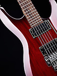 Red electric guitar Ibanez S-series S420 closeup detail on black background