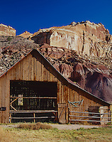 Capitol Reef National Park, UT<br /> Open doors of the Gifford barn at Fruita under the red cliffs of Capitol Reef