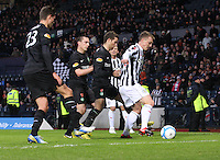 david Barron shields the ball from (left to right) Mikael Lustig, Scott Brown and Adam Matthews in the St Mirren v Celtic Scottish Communities League Cup Semi Final match played at Hampden Park, Glasgow on 27.1.13.