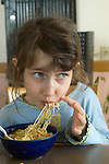 Berkeley CA Girl, six-years-old enjoying nutritious pasta dish MR