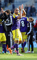 Pictured: Ashley Williams of Swansea thanks away supporters after the final whistle. Saturday 19 April 2014<br /> Re: Barclay's Premier League, Newcastle United v Swansea City FC at St James Park, Newcastle, UK.