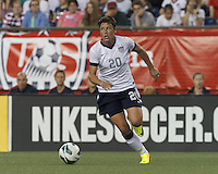 USWNT substitute forward Abby Wambach (20) on the attack.  In an international friendly, the U.S. Women's National Team (USWNT) (white/blue) defeated Korea Republic (South Korea) (red/blue), 4-1, at Gillette Stadium on June 15, 2013.