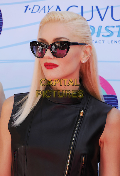 Gwen Stefani of No Doubt.FOX's 2012 Teen Choice Awards held at The Gibson Ampitheatre in Universal City, California, USA..July 22nd, 2012.headshot portrait black leather sunglasses shades red lipstick sleeveless top.CAP/ROT/TM.©Tony Michaels/Roth Stock/Capital Pictures