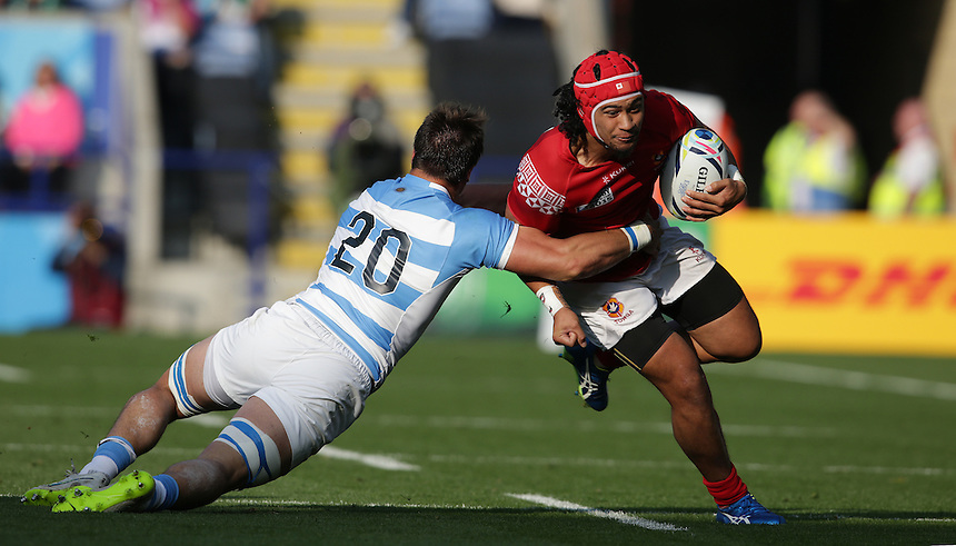 Tonga's Latiume Fosita is tackled by Argentina's Facundo Isa<br /> <br /> Photographer Stephen White/CameraSport<br /> <br /> Rugby Union - 2015 Rugby World Cup Pool C - Argentina v Tonga - Sunday 4th October 2015 - King Power Stadium - Leicester <br /> <br /> &copy; CameraSport - 43 Linden Ave. Countesthorpe. Leicester. England. LE8 5PG - Tel: +44 (0) 116 277 4147 - admin@camerasport.com - www.camerasport.com