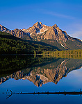 Sawtooth National Recreation Area, ID: Morning light on the peaks of Mount McGown with reflections on Stanley Lake