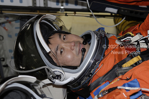 Cape Canaveral, FL - January 21, 2009 --  On Launch Pad 39A at NASA's Kennedy Space Center in Florida, STS-119 Mission Specialist Koichi Wakata is seated in space shuttle Discovery for a simulated launch countdown as part of the prelaunch preparation known as Terminal Countdown Demonstration Test. The TCDT also includes equipment familiarization. Discovery is targeted to launch on the STS-119 mission February 27, 2009.  During the 14-day mission, the crew will install the S6 truss segment and solar arrays to the starboard side of the International Space Station, completing the station's truss, or backbone. .Credit: Kim Shiflett - NASA via CNP